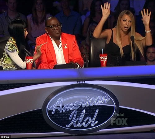 Nicki Minaj taunts Mariah Carey by waving cotton bud at Her on American Idol