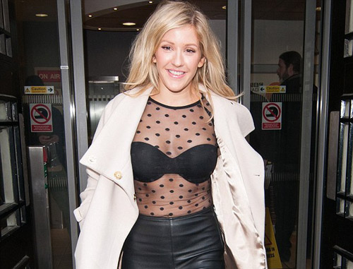 Ellie Goulding Shows off her Strapless bra Under a Sheer Spotted top