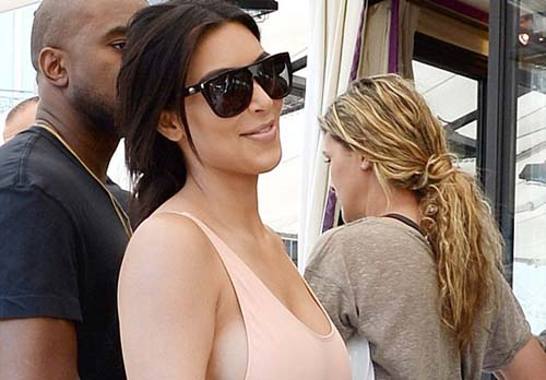 Kim flashes Cheeky hint Side boob Going Bralesspink Vest Kanye Step Paris