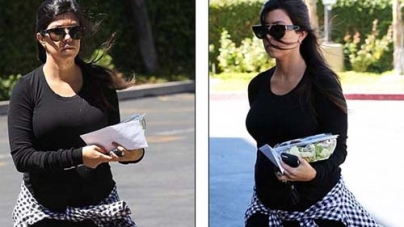Pregnant Kourtney Kardashian shows off her growing baby bump