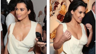 Kim Kardashian in plunging top and matching flared trousers