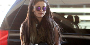 Selena Gomez Makeup-free looks downcast leaving Toronto