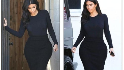 Kim Kardashian looks glum in clinging black