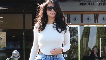 Kim Kardashian in denim Bermuda shorts,  on date with Kanye West