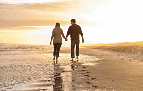 Couple-walking-together-into-the-sunset-Myrtle-Beach-500