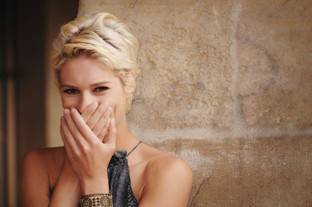 Pretty shy blond woman laughing