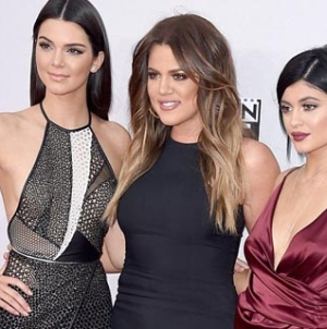 Kendall and Kylie Jenner show some Leg on the AMA Red Carpet