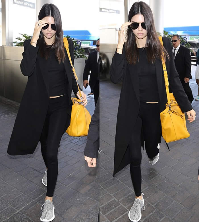 Kendall Jenner pins in tight black leggings
