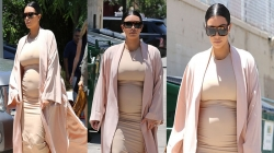 Kim Kardashian Showed Off Baby Bump in Skin Tight Dress