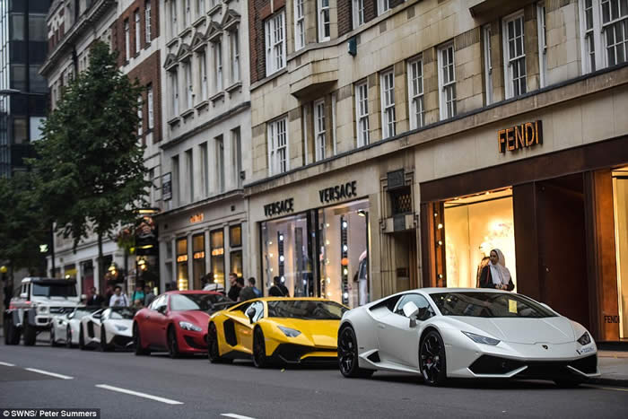 A row of stunning supercars line up outside designer shops Versace and Fendi in Sloane Street, west London