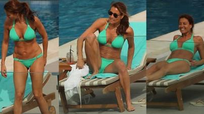 Melanie Sykes, 46, Flaunts Her Washboard Abs in a Skimpy Green Bikini