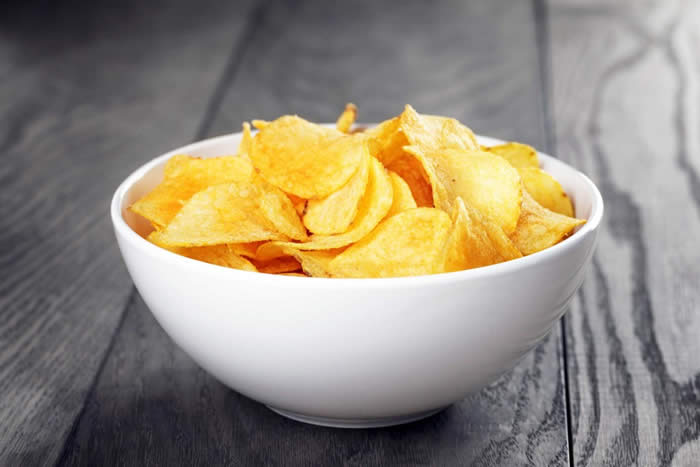 Eat chips from a bowl