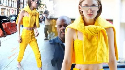 Gigi Hadid cuts a slender frame in preppy bright yellow outfit