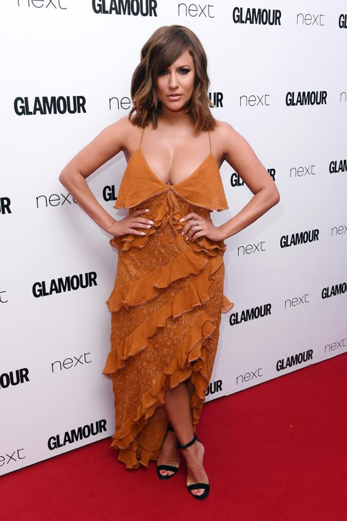 Caroline Flack looked amazing in a mustard coloured tiered dress