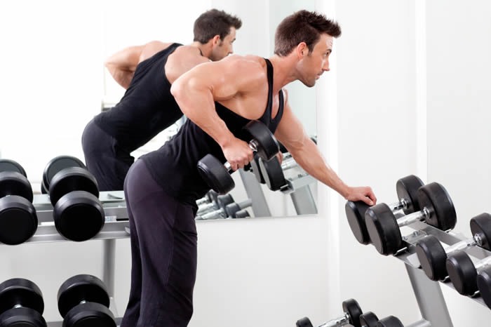 7 Easy Lean Muscle Moves That Only Require 1 Dumbbell