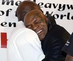 Mike Tyson hugs Evander Holyfield