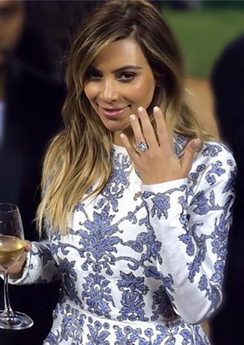 Kim Kardashian showing engagement ring