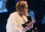 Miley Cyrus smokes