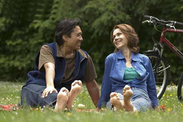 Couple barefoot in park