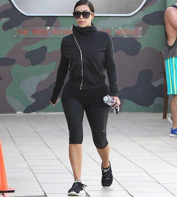 Kim Kardashian in black_jacket and tight leggings