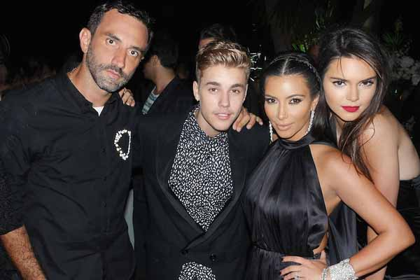 Riccardo Tisci and Kim Kardashian and Kendall Jenner