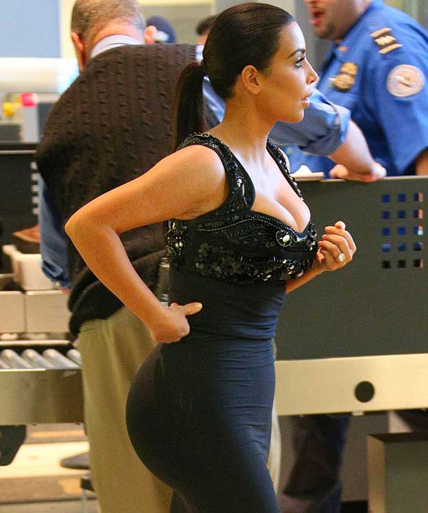 Kim_Kardashian_curves_in_tight_dress_2