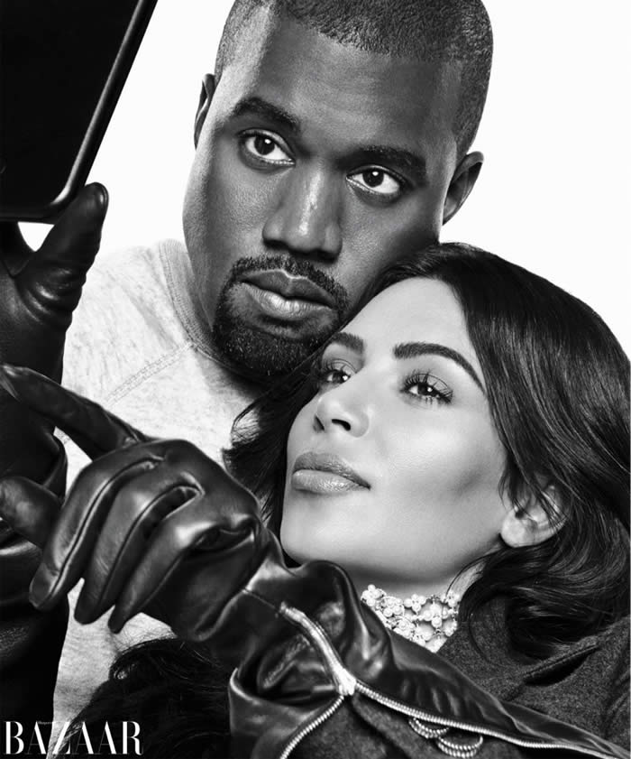 Kanye West and Kim Kardashian take a selfie in black and white